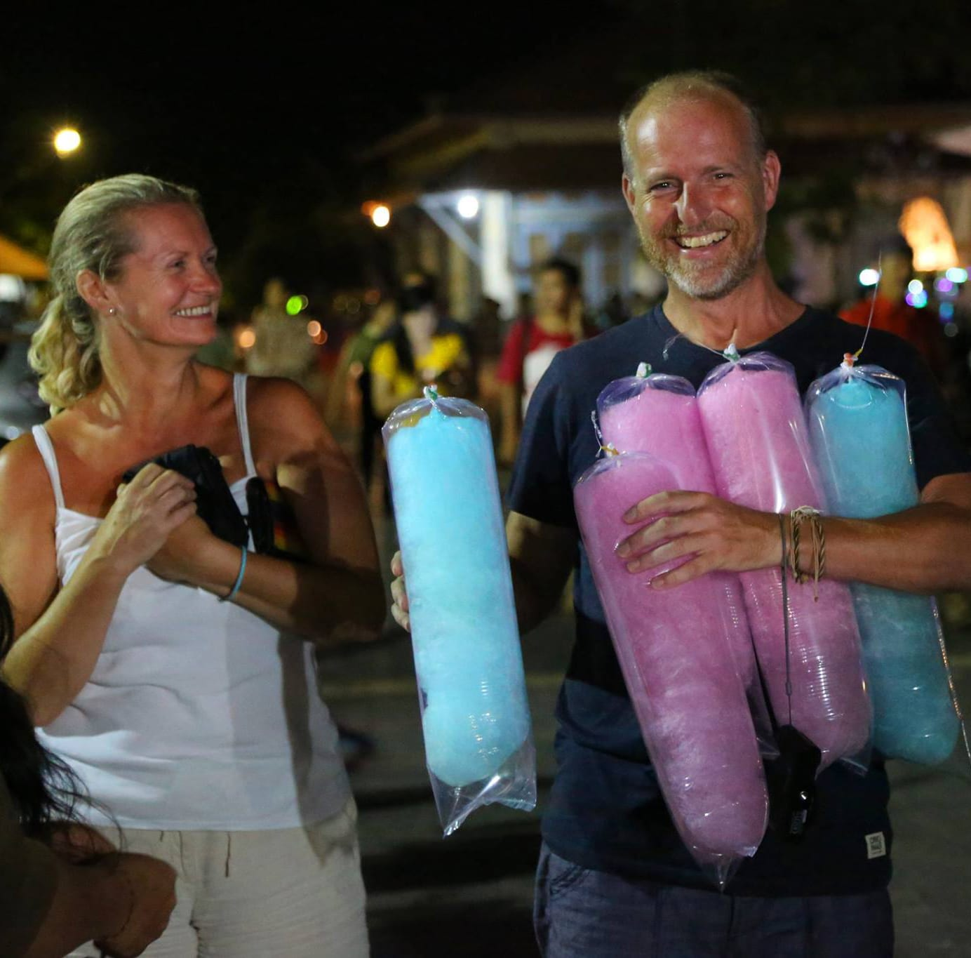 Larch and Alan with arms full of candy floss in Singaraja, Bali | The Silver Nomad