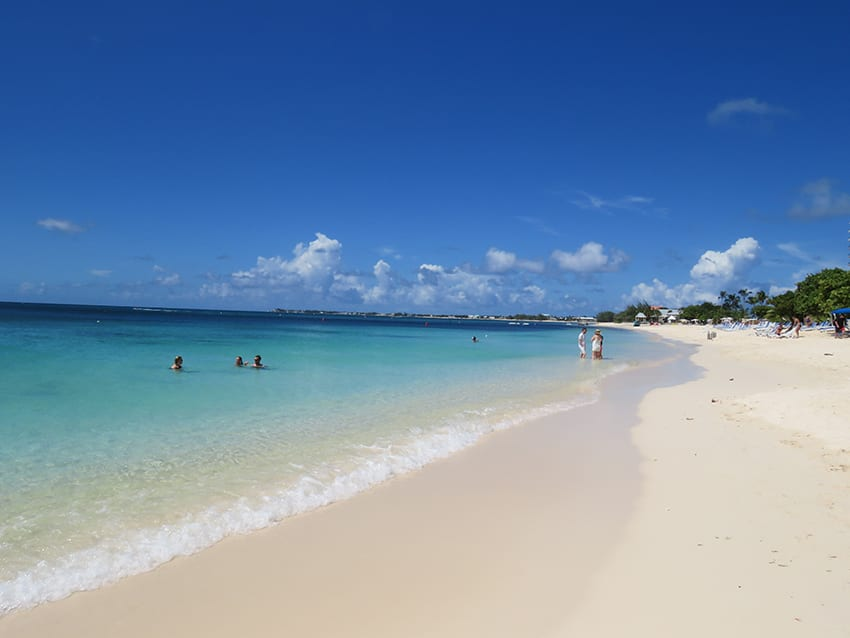 The turquoise sea and white sands at Seven Mile Beach in the Cayman Islands