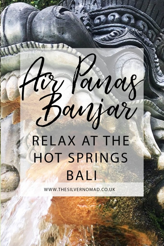 Air Panas Banjar relax at the Hot Springs Bali with stone-carved nagas (mythical dragons) spouting sulphur water
