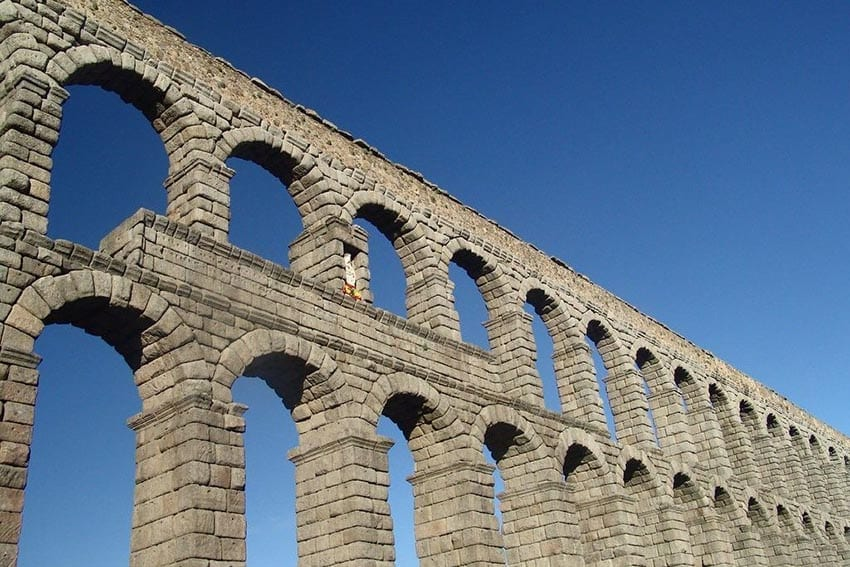 The double arches of the Segovia Aqueduct taken against a blue sky