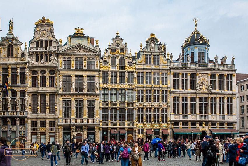The Grand Place in Brussels showing the tall highly decorated buildings around the place