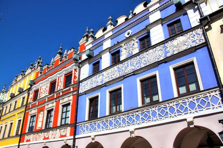 Colourful Tenemnet houses in Zamosc Poland with blue, red and yellow painted facades