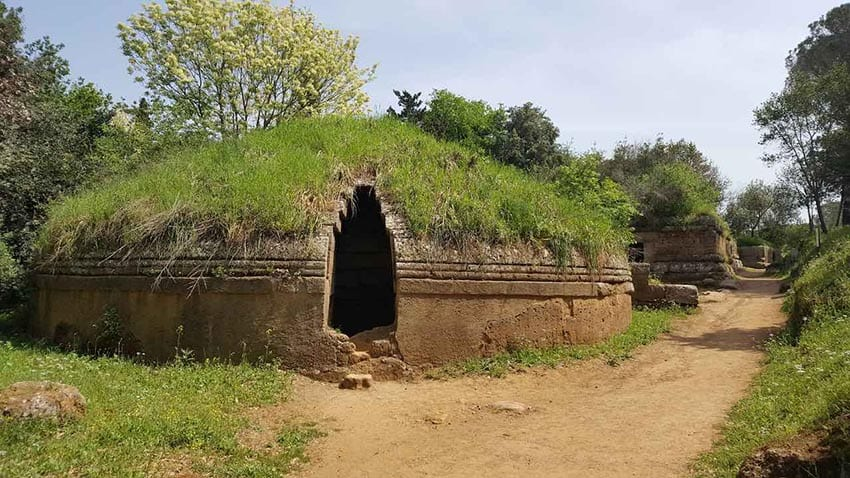 Etruscan Necorpolis a round grass topped clay built tomb