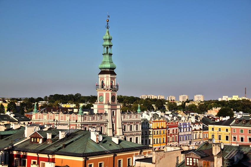 Old town in Zamosc showing roofs of buildings and spire of a church