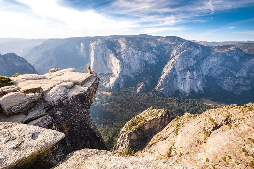 Michele sitting on a rock outcrop in Yosemite park