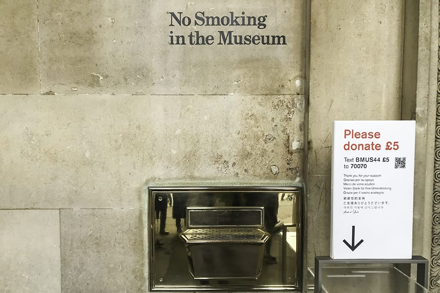 Text on stone wall saying No Smoking in the Museum