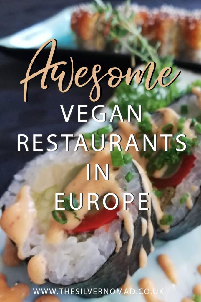 "Vegan sushi in black nori sheets with white rice and red pepper and green avocado with a peach coloured dressing. Writing ""Awesome vegan restaurants in Europe"" superimposed on top"