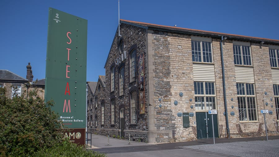 building with green window frames and a banner saying The STEAM Museum
