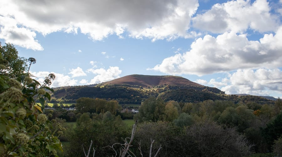 Blorenge mountain in the sunlight with blue skies