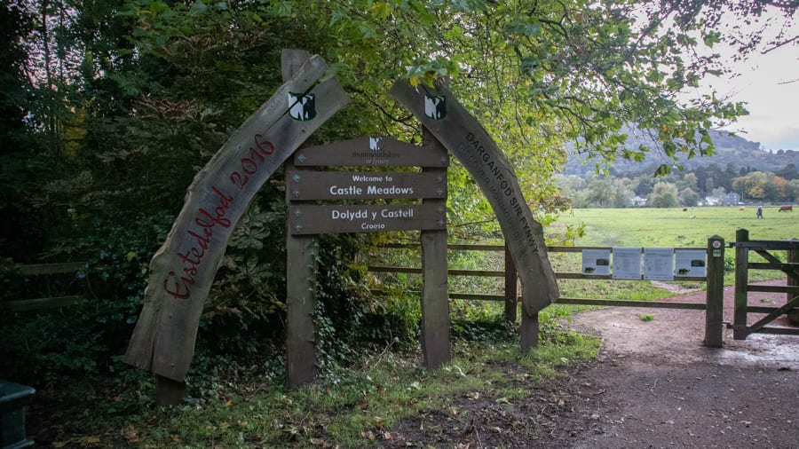 wooden arched and signboard at the entrance to Castle Meadows
