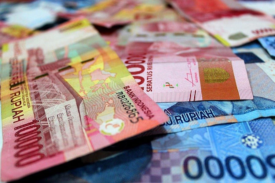 red and blue bank Rupiah notes from Indonesia