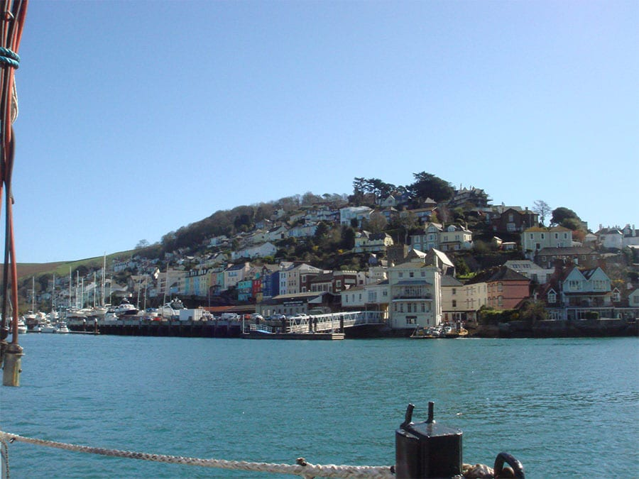 the water in the foreground with the coloured houses of Kingswear