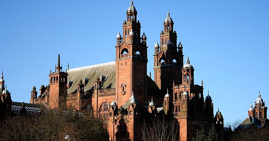 Red sandstone Kelvingrove Art Gallery against a blue sky