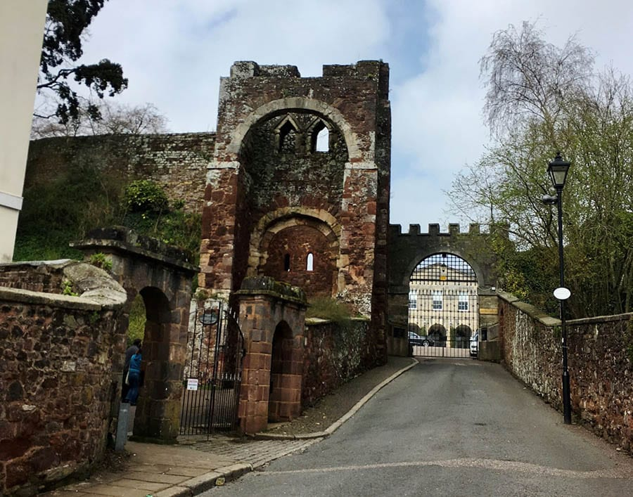 Red stone ruins of Rougemont Castle in Exeter showing the ruined keep with arches
