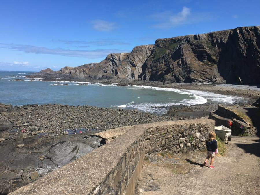 Hartland Quay with a rocky beach and cliff behind