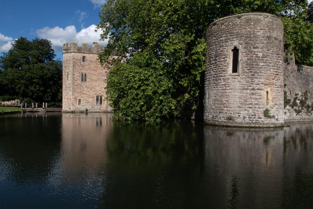 stone built Bishops Palace on a moat with trees in the middle