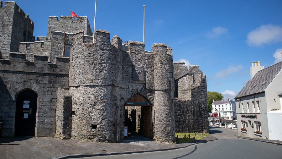 arched entrance to the 13th Century Castle Rushen with crenelations on the walls
