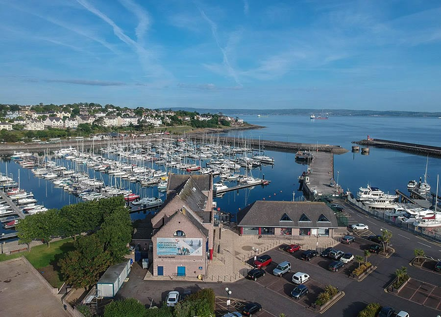 aerial view of Bangor harbour with lines of yachts and a town in the background
