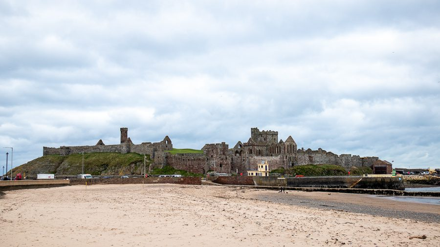 Peel Castle in the distance with sandy beach in front