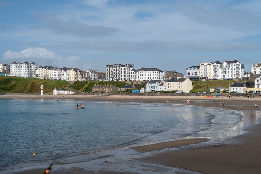 beach with the sea coming in and tall white guest houses behind