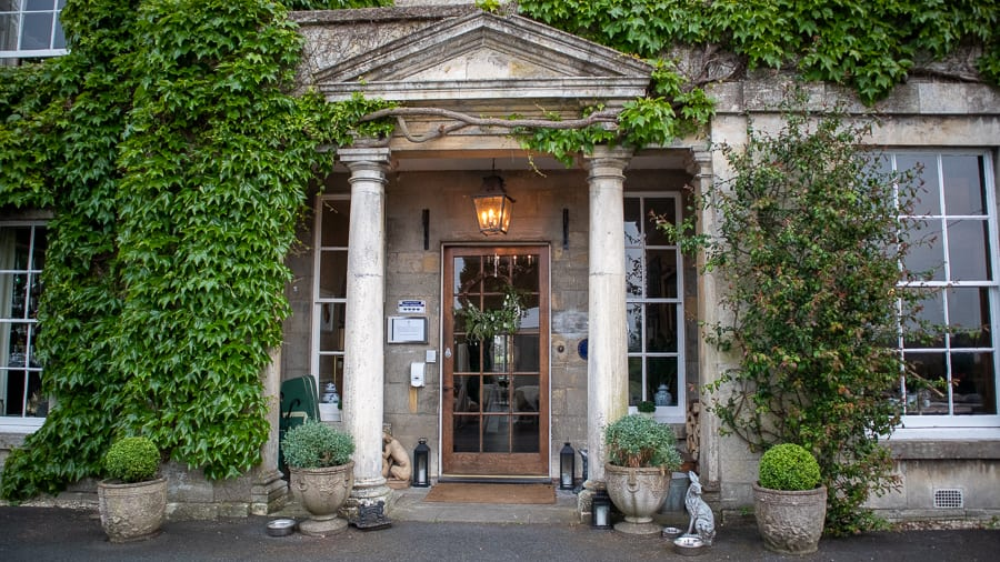 pillared entrance to the Burleigh Court Hotel with ivy to the left and above